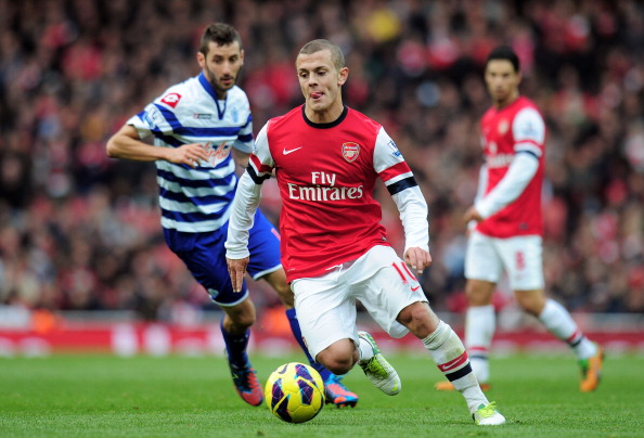 LONDON, ENGLAND - OCTOBER 27:  Jack Wilshere of Arsenal is pursued by Esteban Granero of QPR during the Barclays Premier League match between Arsenal and QPR at The Emirates Stadium on October 27, 2012 in London, England.  (Photo by Shaun Botterill/Getty Images)