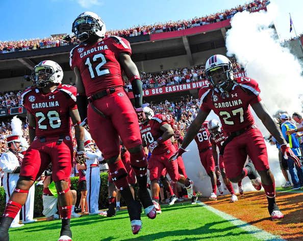 COLUMBIA, SC - SEPTEMBER 22:  Jared Shaw #28, Brison Williams #12 and Victor Hampton #27 of the South Carolina Gamecocks take the field for a game against the Missouri Tigers during play at Williams-Brice Stadium on September 22, 2012 in Columbia, South Carolina.  (Photo by Grant Halverson/Getty Images)