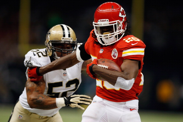 NEW ORLEANS, LA - SEPTEMBER 23:    Jamaal Charles #25 of the Kansas City Chiefs is tackled by  Jonathan Casillas #52 of the New Orleans Saints at the Mercedes-Benz Superdome on September 23, 2012 in New Orleans, Louisiana.  (Photo by Chris Graythen/Getty Images)