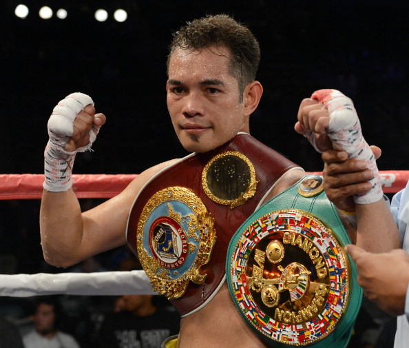 CARSON, CA - OCTOBER 13:  Nonito Donaire of The Phillipines poses with the belt after his ninth round TKO of Toshioka Nishioka of Japan during the WBO Super Bantamweight Title fight at The Home Depot Center on October 13, 2012 in Carson, California.  (Photo by Harry How/Getty Images)