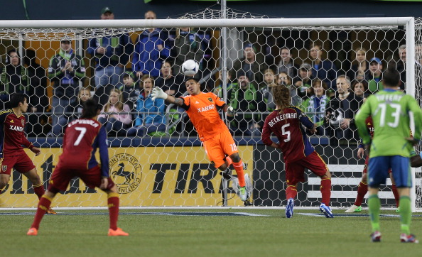 SEATTLE, WA - NOVEMBER 02:  Goalkeeper Nick Rimando #18 of Real Salt Lake blocks a shot against the Seattle Sounders FC at CenturyLink Field on November 2, 2012 in Seattle, Washington.  (Photo by Otto Greule Jr/Getty Images)