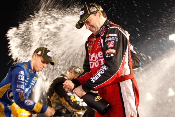 RICHMOND, VA - SEPTEMBER 10:  Brad Keselowski, driver of the #2 Miller Lite Dodge, and Tony Stewart, driver of the #14 Office Depot/Mobil 1 Chevrolet, celebrate after clinching a spot in the 'Chase for the Sprint Cup' following the NASCAR Sprint Cup Series Wonderful Pistachios 400 at Richmond International Raceway on September 10, 2011 in Richmond, Virginia.  (Photo by Chris Graythen/Getty Images)