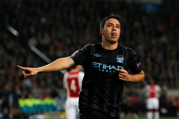 AMSTERDAM, NETHERLANDS - OCTOBER 24:  Samir Nasri of Manchester City celebrates scoring the first goal of the game during the Group D UEFA Champions League match between AFC Ajax and Manchester City FC at Amsterdam ArenA on October 24, 2012 in Amsterdam, Netherlands.  (Photo by Dean Mouhtaropoulos/Getty Images)