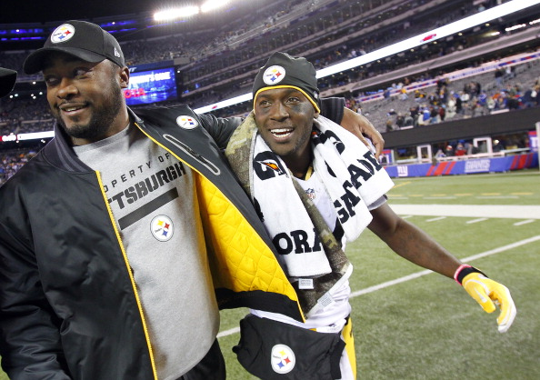 EAST RUTHERFORD, NJ - NOVEMBER 4: Head coach Mike Tomlin of the Pittsburgh Steelers walks off the field with Antonio Brown #84 after defeating the New York Giants 24-20 during an NFL game at MetLife Stadium on November 4, 2012 in East Rutherford, New Jersey. (Photo by Rich Schultz /Getty Images)