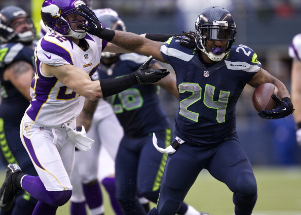 SEATTLE, WA - NOVEMBER 4: Marshawn Lynch #24 of the Seattle Seahawks escapes the tackle of Harrison Smith #22 of the Minnesota Vikings during a game at CenturyLink Field on November 4, 2012 in Seattle, Washington. The Seahawks 30-20. (Photo by Stephen Brashear/Getty Images)