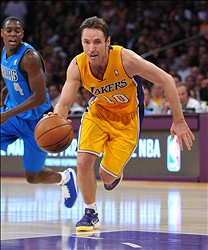 October 30, 2012; Los Angeles, CA, USA;    Dallas Mavericks point guard Darren Collison (4) looks on as Los Angeles Lakers point guard Steve Nash (10) drives to the basket in the second half of the game at the Staples Center. Dallas won 99-91. Mandatory Credit: Jayne Kamin-Oncea-US PRESSWIRE