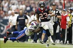 Nov 4, 2012; Houston, TX, USA; Houston Texans running back Arian Foster (23) runs the ball past Buffalo Bills cornerback Leodis McKelvin (21) in the fourth quarter at Reliant Stadium. The Texans defeated the Bills 21-9. Mandatory Credit: Brett Davis-US PRESSWIRE