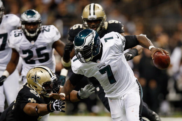 NEW ORLEANS, LA - NOVEMBER 05:   Michael Vick #7 of the Philadelphia Eagles avoids a tackle by  Will Smith #91 of the New Orleans Saints at Mercedes-Benz Superdome on November 5, 2012 in New Orleans, Louisiana.  (Photo by Chris Graythen/Getty Images)