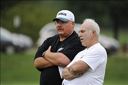Aug 04, 2011; Bethlehem, PA, USA; Philadelphia Eagles head coach Andy Reid (L) talks with Eagles chairman and CEO Jeffrey Lurie (R) during training camp at Lehigh University. Mandatory Credit: Howard Smith-US PRESSWIRE