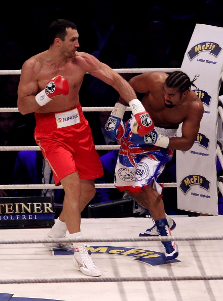 HAMBURG, GERMANY - JULY 02:  Wladimir Klitschko of Ukraine attempts a left hook on David Haye of England during their heavy weight unification match at the Imtech Arena on July 2, 2011 in Hamburg, Germany.  (Photo by Scott Heavey/Getty Images)
