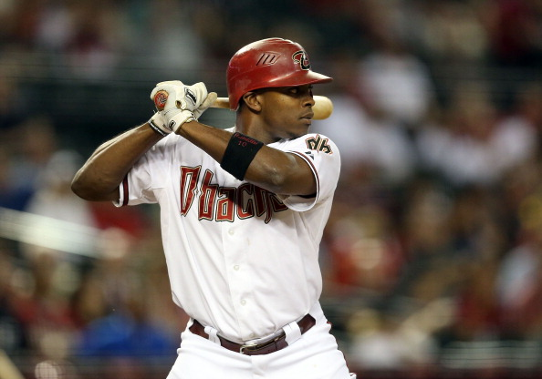 PHOENIX, AZ - OCTOBER 02:  Justin Upton #10 of the Arizona Diamondbacks bats against the Colorado Rockies during the MLB game at Chase Field on October 2, 2012 in Phoenix, Arizona.  The Diamondbacks defeated the Rockies 5-3.  (Photo by Christian Petersen/Getty Images)