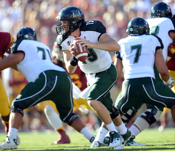 LOS ANGELES, CA - SEPTEMBER 01:  Sean Schroeder #19 of the Hawaii Warriors rolls out of the pocket agaisnt the USC Trojans at Los Angeles Coliseum on September 1, 2012 in Los Angeles, California.  (Photo by Harry How/Getty Images)