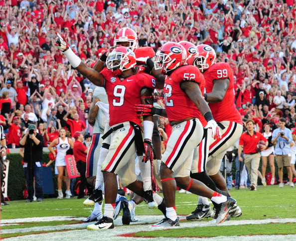 ATHENS, GA - NOVEMBER 3: Alec Ogletree #9 of the Georgia Bulldogs is congratulated by teammates after making a tackle for a safety against the Ole Miss Rebels at Sanford Stadium on November 3, 2012 in Athens, Georgia. (Photo by Scott Cunningham/Getty Images)