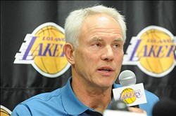 Dec. 2 2011;  El Segundo, CA., USA; Los Angeles Lakers general manager Mitch Kupchak answers questions from the media during a press conference at the team training compound at the Toyota Sports Center. Mandatory Credit: Jayne Kamin-Oncea-US PRESSWIRE