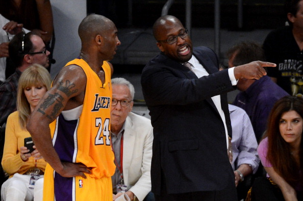 LOS ANGELES, CA - MAY 12:  Kobe Bryant #24 talks with head coach Mike Brown of the Los Angeles Lakers in the second half while taking on the Denver Nuggets in Game Seven of the Western Conference Quarterfinals in the 2012 NBA Playoffs on May 12, 2012 at Staples Center in Los Angeles, California. NOTE TO USER: User expressly acknowledges and agrees that, by downloading and or using this photograph, User is consenting to the terms and conditions of the Getty Images License Agreement.  (Photo by Kevork Djansezian/Getty Images)
