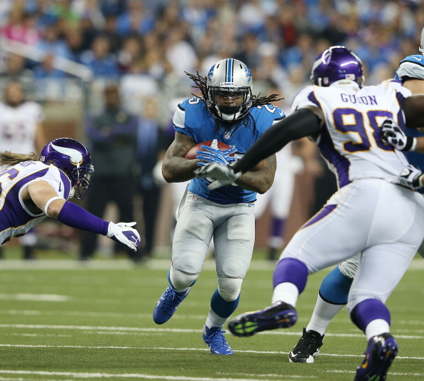 DETROIT, MI - SEPTEMBER 30:  Mikel Leshoure #25 of the Detroit Lions runs for a first down as Brian Robinson #96 and Letroy Guion #98 of the Minnesota Vikings make the stop during the game at Ford Field on September 30, 2012 in Detroit, Michigan. The Vikings defeated the Lions 20-13.  (Photo by Leon Halip/Getty Images)