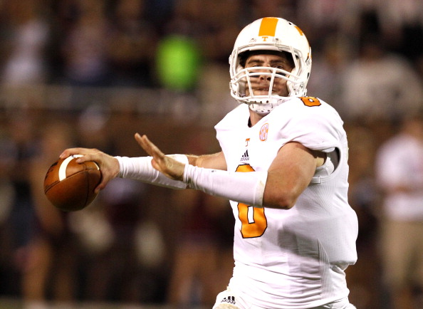 STARKVILLE, MS - OCTOBER 13:  Quarterback Tyler Bray #8 of the Tennessee Volunteers rolls out to pass against the Mississippi State Bulldogs on October 13, 2012 at Davis Wade Stadium in Starkville, Mississippi. (Photo by Butch Dill/Getty Images)