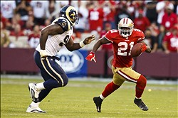 November 14, 2010; San Francisco, CA, USA;  San Francisco 49ers running back Frank Gore (21) rushes past St. Louis Rams defensive end James Hall (96) during overtime at Candlestick Park. San Francisco defeated St. Louis 23-20 in overtime. Mandatory Credit: Jason O. Watson-US PRESSWIRE