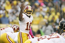 October 28, 2012; Pittsburgh, PA, USA; Washington Redskins quarterback Robert Griffin III (10) calls an audible at the line of scrimmage against the Pittsburgh Steelers during the second quarter at Heinz Field. Mandatory Credit: Charles LeClaire-US PRESSWIRE