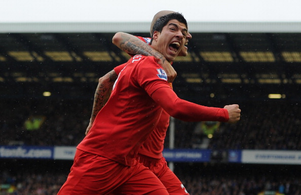 LIVERPOOL, ENGLAND - OCTOBER 28:  Luis Suarez of Liverpool celebrates scoring his team's second goal with team mate Martin Skrtel (L)  during the Barclays Premier League match between Everton and Liverpool at Goodison Park on October 28, 2012 in Liverpool, England.  (Photo by Chris Brunskill/Getty Images)