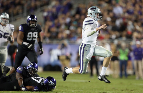 FORT WORTH, TX - NOVEMBER 10:  Collin Klein #7 of the Kansas State Wildcats runs for a touchdown against the TCU Horned Frogs at Amon G. Carter Stadium on November 10, 2012 in Fort Worth, Texas.  (Photo by Ronald Martinez/Getty Images)
