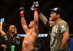 Jul. 7, 2012; Las Vegas, NV, USA; UFC fighter Cung Le (center) celebrates his win over Patrick Coto during a middleweight bout in UFC 148 at the MGM Grand Garden Arena. Mandatory