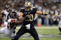 November 11, 2012; New Orleans, LA, USA;  New Orleans Saints tight end Jimmy Graham (80) carries the ball up the field against Atlanta Falcons strong safety William Moore (25) during the second quarter at the Mercedes-Benz Superdome.  Mandatory Credit: John David Mercer-US PRESSWIRE
