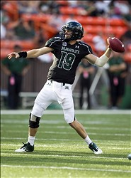 Sept 22, 2012; Honolulu, HI, USA;  Hawaii Warriors quarterback Sean Schroeder (19) throws a pass against Nevada Wolf Pack during the second quarter of the NCAA college football game at Aloha Stadium.  Mandatory Credit:  Marco Garcia-US PRESSWIRE