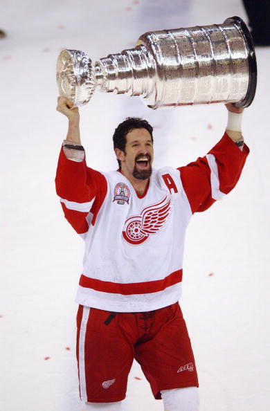 DETROIT, MI - JUNE 13:  Brendan Shanahan #14 of the Detroit Red Wings hoists the Stanley Cup after defeating the Carolina Hurricanes 3-1 in game five of the NHL Stanley Cup Finals on June 13, 2002 at the Joe Louis Arena in Detroit, Michigan. Shanahan scored two goals during the game. (Photo by Harry How/Getty Images/NHLI)
