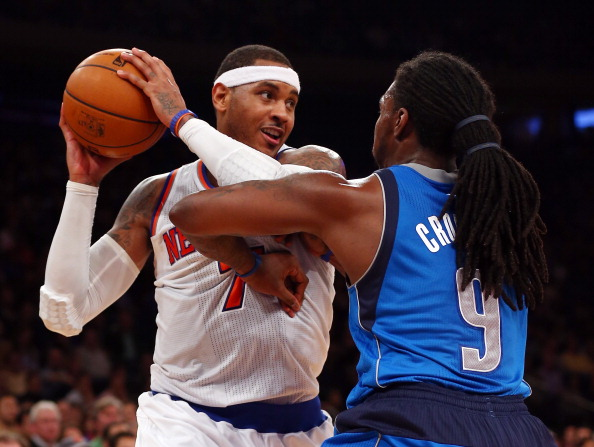 NEW YORK, NY - NOVEMBER 09:  Carmelo Anthony #7 of the New York Knicks tries to get around Jae Crowder #9 of the Dallas Mavericks on November 9, 2012 at Madison Square Garden in New York City.The New York Knicks defeated the Dallas Mavericks 104-94. NOTE TO USER: User expressly acknowledges and agrees that, by downloading and/or using this photograph, user is consenting to the terms and conditions of the Getty Images License Agreement.  (Photo by Elsa/Getty Images)