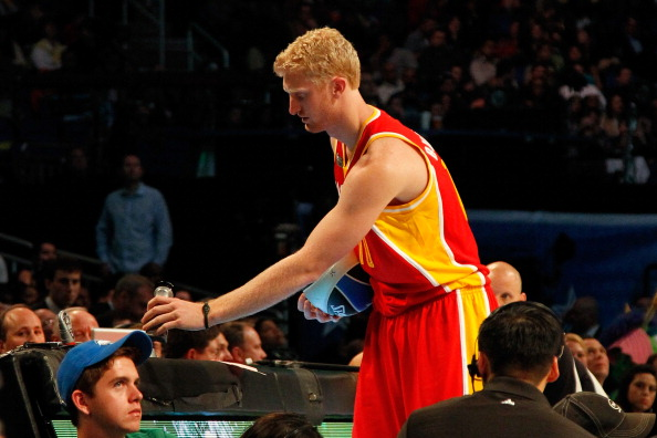 ORLANDO, FL - FEBRUARY 25:  Chase Budinger of the Houston Rockets applies Court Grip prior to attempting a dunk during the Sprite Slam Dunk Contest part of 2012 NBA All-Star Weekend at Amway Center on February 25, 2012 in Orlando, Florida.  NOTE TO USER: User expressly acknowledges and agrees that, by downloading and or using this photograph, User is consenting to the terms and conditions of the Getty Images License Agreement.  (Photo by Mike Ehrmann/Getty Images)