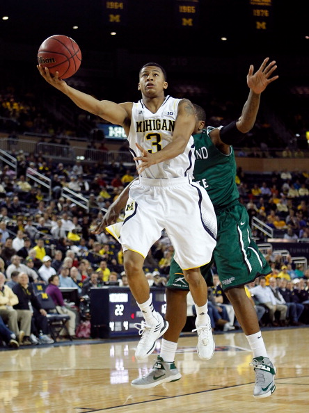 ANN ARBOR, MI - NOVEMBER 13:  Trey Burke #3 of the Michigan Wolverines gets to the basket past Anton Grady #15 of the Cleveland State Vikings at Crisler Center during the NIT Season Tip-Off on November 13, 2012 in Ann Arbor, Michigan.  (Photo by Gregory Shamus/Getty Images)