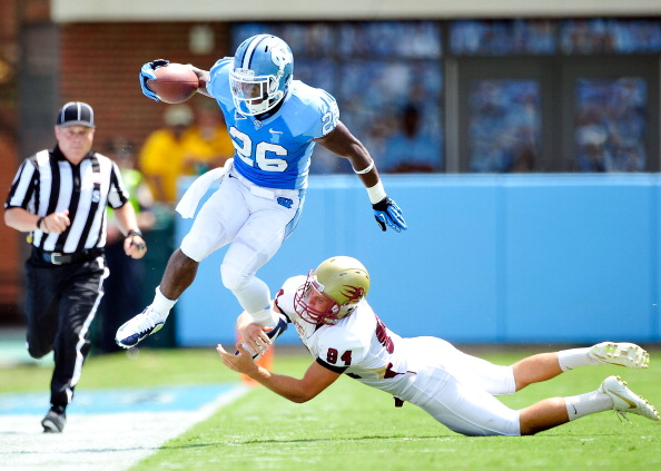 CHAPEL HILL, NC - SEPTEMBER 01:  Giovani Bernard #26 of the North Carolina Tar Heels leaps out of a tackle by Kenton Beal #84 of the Elon Phoenix during play at Kenan Stadium on September 1, 2012 in Chapel Hill, North Carolina.  (Photo by Grant Halverson/Getty Images)