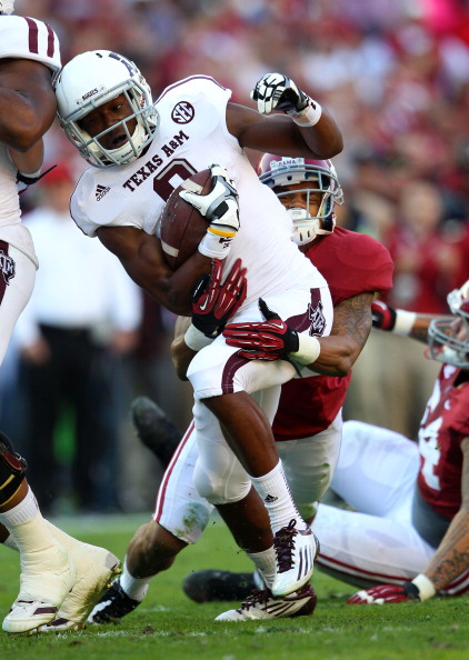 TUSCALOOSA, AL - NOVEMBER 10:  Wide receiver Thomas Johnson #8 of the Texas A&M Aggies is tackled by defensive back Dee Milliner #28 of the Alabama Crimson Tide during the game at Bryant-Denny Stadium on November 10, 2012 in Tuscaloosa, Alabama.  (Photo by Mike Zarrilli/Getty Images)