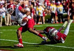 November 10, 2012; Columbia, SC, USA; Arkansas Razorbacks wide receiver Keon Hatcher (4) scores a touchdown past South Carolina Gamecocks linebacker Reginald Bowens (47) in the first half at Williams-Brice Stadium. Mandatory Credit: Jeff Blake-US PRESSWIRE