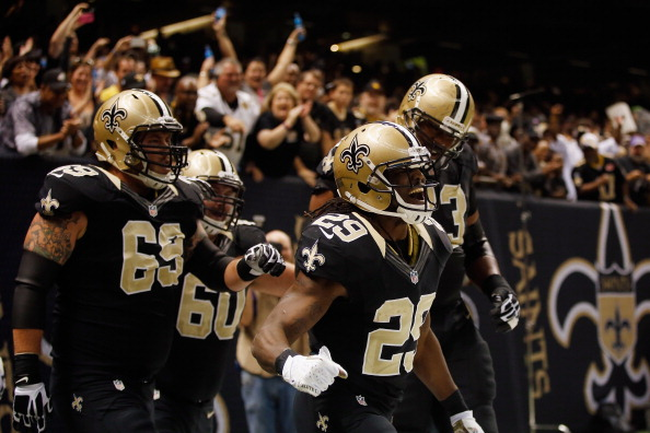 NEW ORLEANS, LA - NOVEMBER 11:  Chris Ivory #29 of the New Orleans Saints reacts after scoring a touchdown against the Atlanta Falcons at The Mercedes-Benz Superdome on November 11, 2012 in New Orleans, Louisiana.  (Photo by Chris Graythen/Getty Images)