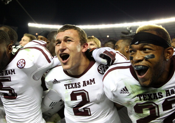 TUSCALOOSA, AL - NOVEMBER 10:  Quarterback Johnny Manziel #2, defensive back Dustin Harris #22 and wide receiver Kenric McNeal #5 of the Texas A&M Aggies celebrate after the game against the Alabama Crimson Tide Texas A&M Aggies at Bryant-Denny Stadium on November 10, 2012 in Tuscaloosa, Alabama.  The Aggies beat the Crimson Tide 29-24.  (Photo by Mike Zarrilli/Getty Images)