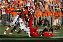 Nov 10, 2012; Clemson, SC, USA; Clemson Tigers wide receiver Sammy Watkins (2) is brought down by Maryland Terrapins defensive back Jeremiah Johnson (14) during the first quarter at Clemson Memorial Stadium. Mandatory Credit: Joshua S. Kelly-US PRESSWIRE