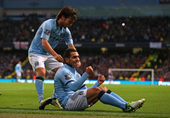 MANCHESTER, ENGLAND - NOVEMBER 17:  Carlos Tevez of Manchester City celebrates scoring his team's third goal, from the penalty spot, to make the score 3-0 with team-mate David Silva (L) during the Barclays Premier League match between Manchester City and Aston Villa at the Etihad Stadium on November 17, 2012 in Manchester, England.  (Photo by Alex Livesey/Getty Images)