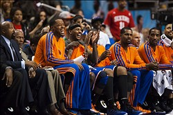 Nov 05, 2012; Philadelphia, PA, USA; New York Knicks forward Carmelo Anthony (7) (grey top and sweat band) has a laugh with teammates on the bench during the fourth quarter against the Philadelphia 76ers at the Wachovia Center. The Knicks defeated the Sixers 110-88. Mandatory Credit: Howard Smith-US PRESSWIRE