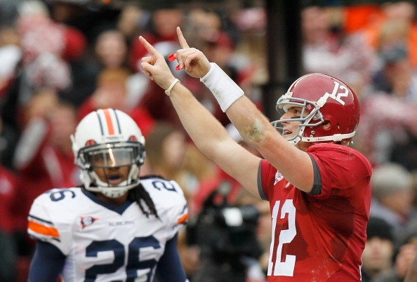 TUSCALOOSA, AL - NOVEMBER 26:  Quarterback Greg McElroy #12 of the Alabama Crimson Tide reacts a throwing for a touchdown against the Auburn Tigers at Bryant-Denny Stadium on November 26, 2010 in Tuscaloosa, Alabama.  (Photo by Kevin C. Cox/Getty Images)