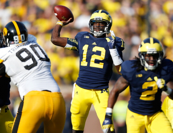 ANN ARBOR, MI - NOVEMBER 17:  Devin Gardner #12 of the Michigan Wolverines throws a third quarter pass while playing the Iowa Hawkeyes at Michigan Stadium on November 17, 2012 in Ann Arbor, Michigan. Michigan won the game 42-17. (Photo by Gregory Shamus/Getty Images)