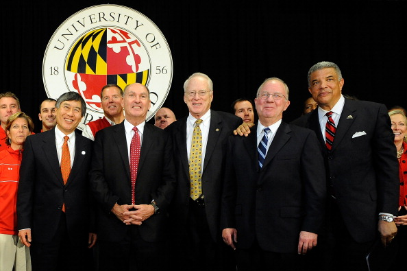 COLLEGE PARK, MD - NOVEMBER 19:  (L to R) University of Maryland President Wallace D. Loh, Big Ten Commissioner James E. Delany, University System of Maryland Chancellor Brit Kirwan, University System of Maryland Chairman of the Board of Regents James L. Shea, and Director of Athletics Kevin Anderson stand for a photo after a press conference announcing that University of Maryland is joining the Big Ten Conference on November 19, 2012 in College Park, Maryland.  (Photo by Patrick McDermott/Getty Images)