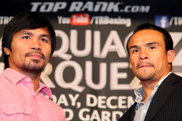 BEVERLY HILLS, CA - SEPTEMBER 17:  (L-R) Manny Pacquiao and Juan Manuel Marquez stand onstage to face the media cameras during the Manny Pacquiao v Juan Manuel Marquez - Press Conference at Beverly Hills Hotel on September 17, 2012 in Beverly Hills, California.  (Photo by Victor Decolongon/Getty Images)