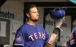 September 7, 2012; St. Petersburg, FL, USA; Texas Rangers left fielder Josh Hamilton (32) in the dugout against the Tampa Bay Rays at Tropicana Field. Mandatory Credit: Kim Klement-US PRESSWIRE