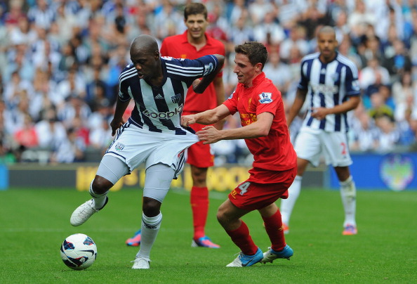 WEST BROMWICH, ENGLAND - AUGUST 18:  Joe Allen of Liverpool battles Youssouf Mulumbu of West Brom during the Barclays Premier League match between West Bromwich Albion and Liverpool at The Hawthorns on August 18, 2012 in West Bromwich, England.  (Photo by Michael Regan/Getty Images)