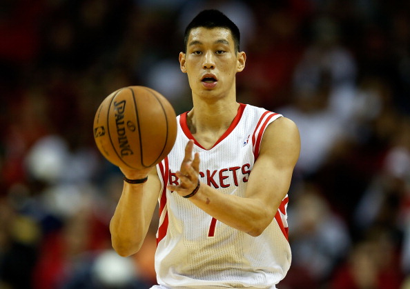 HOUSTON, TX - NOVEMBER 12:  Jeremy Lin #7 of the Houston Rockets passes the ball against the Miami Heat at the Toyota Center on November 12, 2012 in Houston, Texas. NOTE TO USER: User expressly acknowledges and agrees that, by downloading and or using this photograph, User is consenting to the terms and conditions of the Getty Images License Agreement.  (Photo by Scott Halleran/Getty Images)