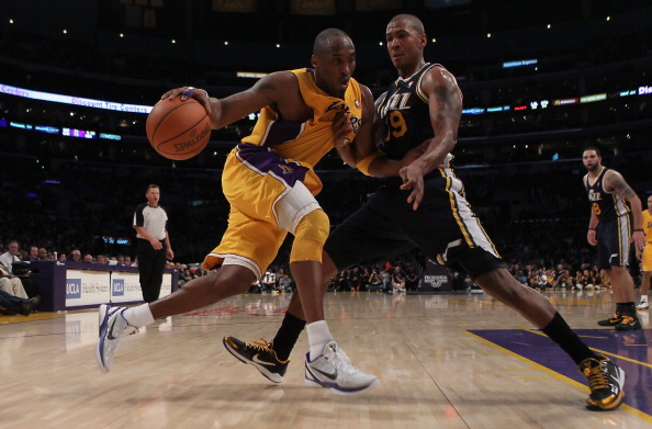 LOS ANGELES, CA - JANUARY 25:  Kobe Bryant #24 of the Los Angeles Lakers drives to the basket while being defended by Raja Bell #19 of the Utah Jazz in the second half at Staples Center on January 25, 2011 in Los Angeles, California. The Lakers defeated the Jazz 120-91. NOTE TO USER: User expressly acknowledges and agrees that, by downloading and or using this photograph, User is consenting to the terms and conditions of the Getty Images License Agreement.  (Photo by Jeff Gross/Getty Images)