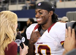 Nov 22, 2012; Arlington, TX, USA; Washington Redskins quarterback Robert Griffin III (10) smiles while being interviewed by Fox reporter Erin Andrews (left) after winning the game against the Dallas Cowboys on Thanksgiving at Cowboys Stadium. The Redskins beat the Cowboys 38-31. Mandatory Credit: Tim Heitman-US PRESSWIRE