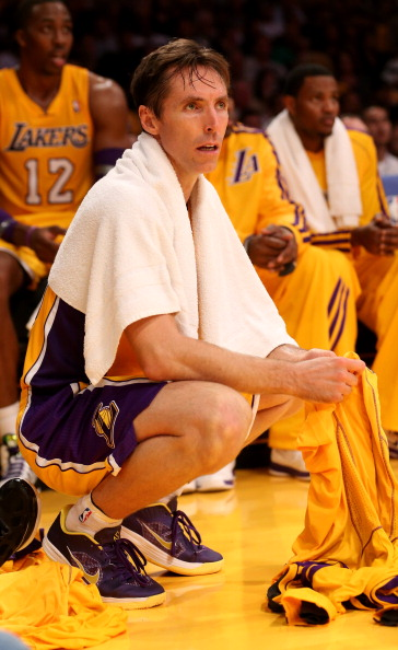 LOS ANGELES, CA - OCTOBER 30: Steve Nash #10 of the Los Angeles Lakers looks on from the sideline during the game wtih the Dallas Mavericks at Staples Center on October 30, 2012 in Los Angeles, California.  The Mavericks won 99-91.  NOTE TO USER: User expressly acknowledges and agrees that, by downloading and or using this photograph, User is consenting to the terms and conditions of the Getty Images License Agreement.  (Photo by Stephen Dunn/Getty Images)